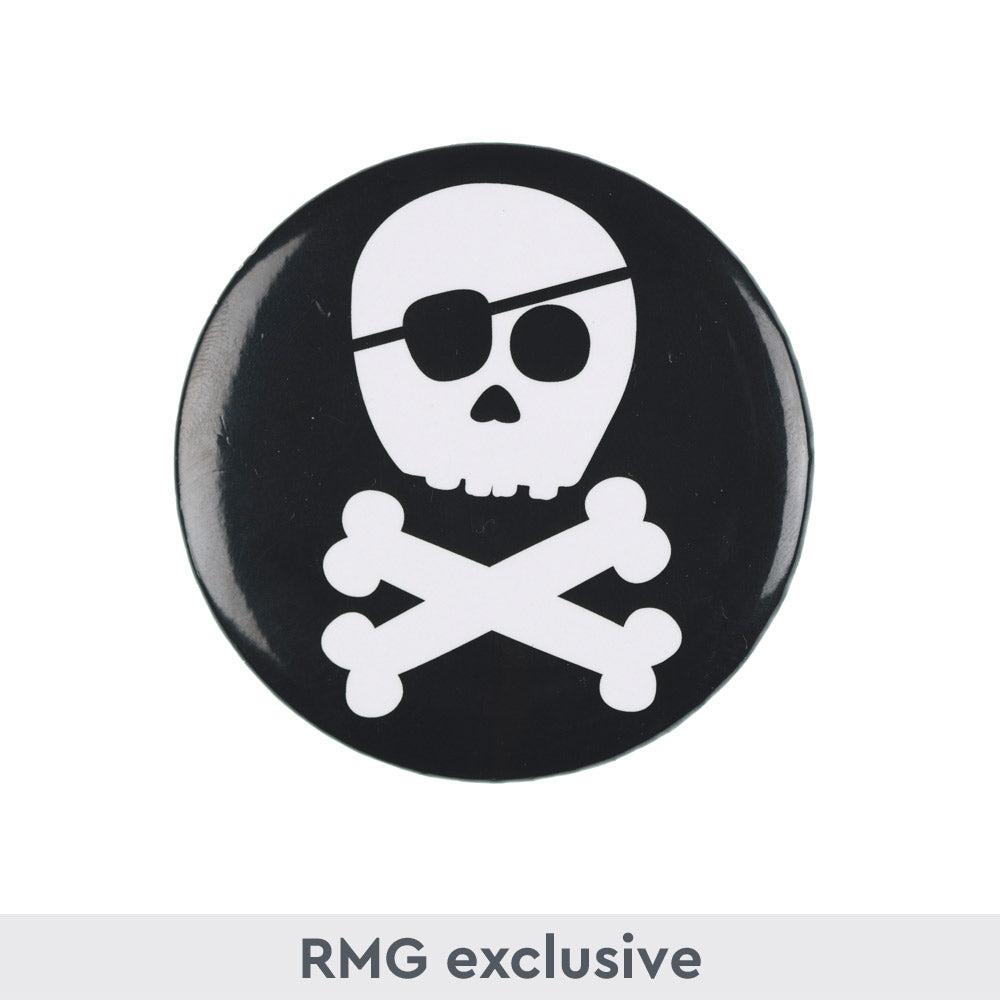 Black button badge with white cartoon skull and cross bones