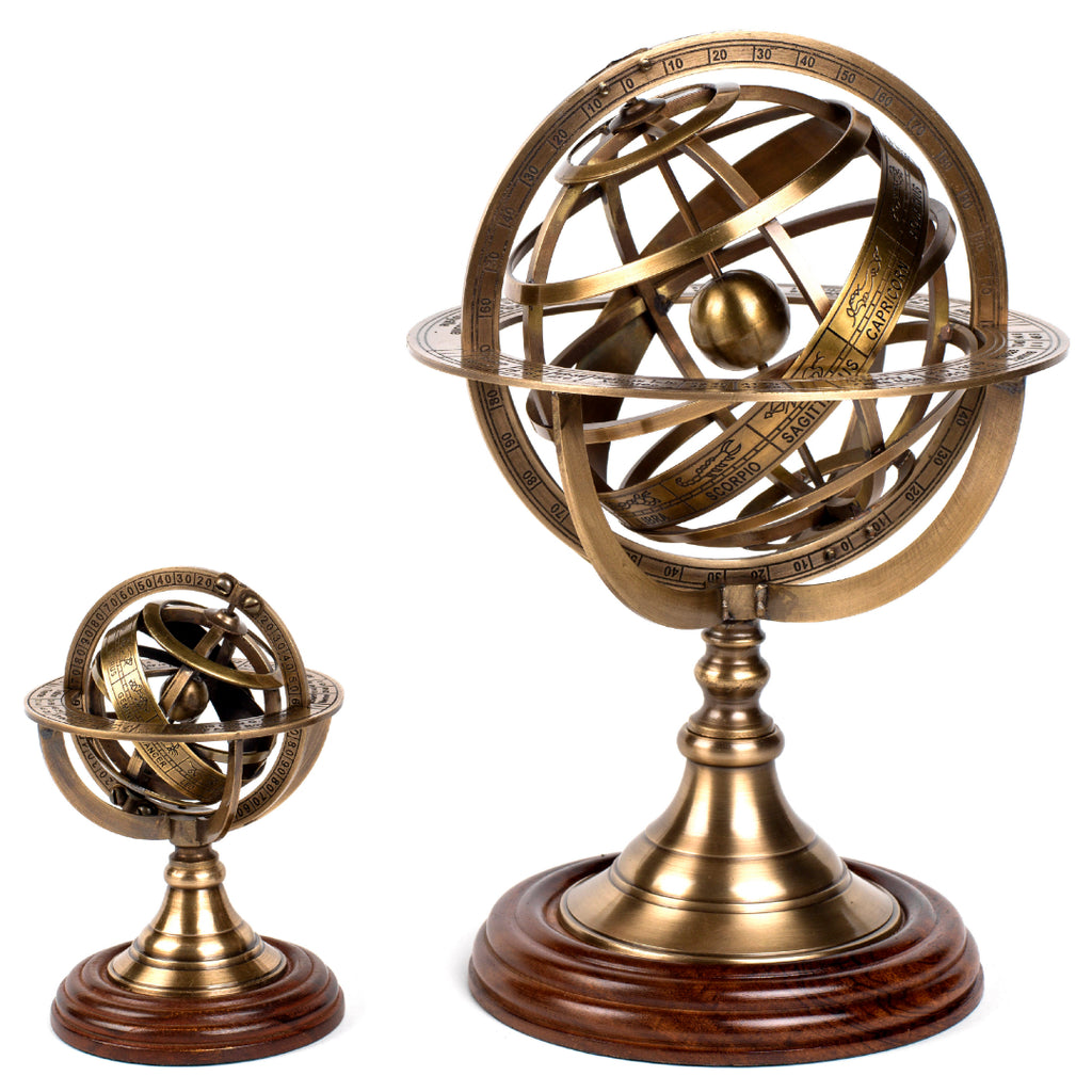 Bronze armillary spheres with wooden bases side by side small and large to show difference in height
