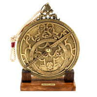 astrolabe resting on wooden stand