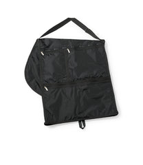Folded black garment bag with convertible shoulder strap and 3 zippered front pockets