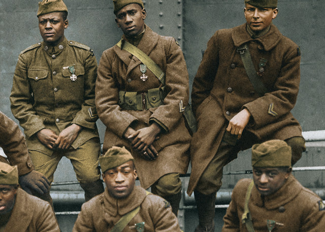 1919: Soldiers of the 369th 'Harlem Hellfighters' wearing the Cross of War medal pose for a photo on their trip back to New York