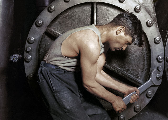 1920: 'Powerhouse mechanic working on steam pump' by Lewis Hine