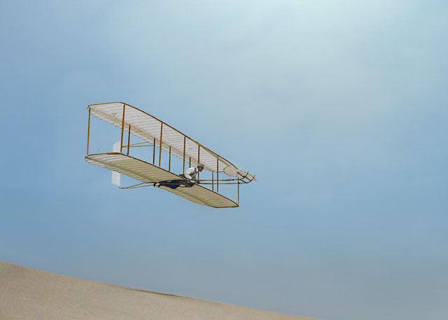 1902:  Wilbur Wright gliding down steep slope of Big Kill Devil Hill