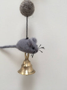 Close up picture of a felt cat door garland featuring a grey mouse on a string and a gold colored bell