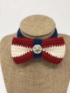 Picture of a red, white, and blue colored hand-knitted pet collar bow tie around a tan brown bust