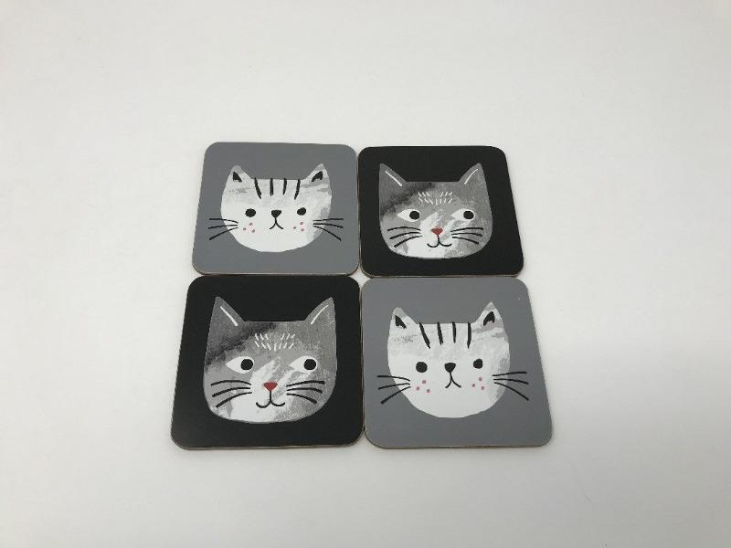 Four cat-themed drink coasters featuring grey and white cats