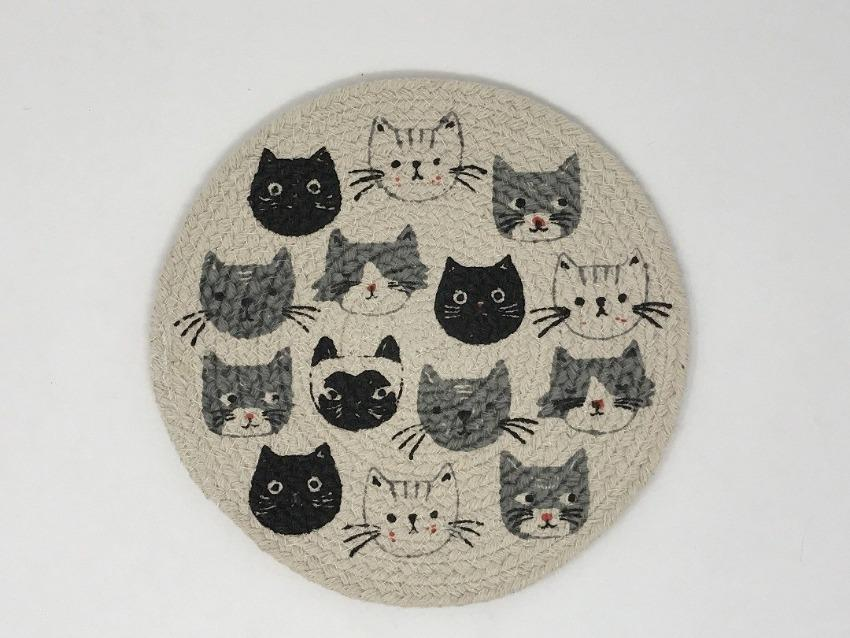 Hand-crocheted trivet featuring black cats, white cats, and grey cats