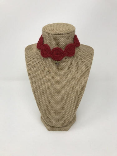 Picture of a red pet collar with a gold colored charm around a tan brown bust