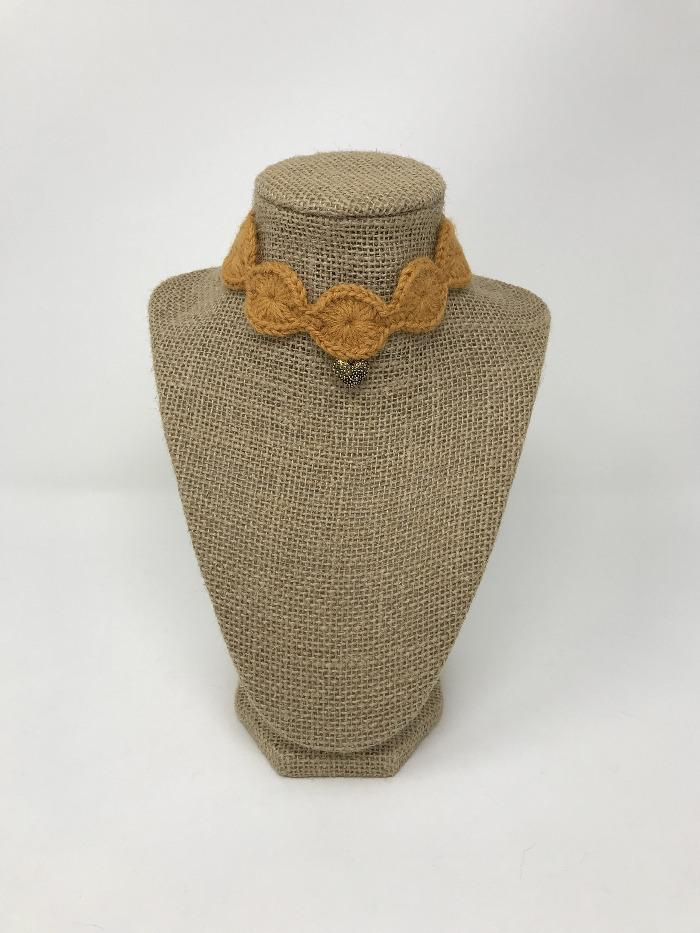 Picture of a ginger colored pet collar with a gold colored charm around a tan brown bust