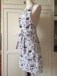 Black and white kitchen apron on a white mannequin showcasing the side of the apron