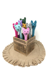 Load image into Gallery viewer, Picture of a collection of different colored felt cat pens inside of a wooden box
