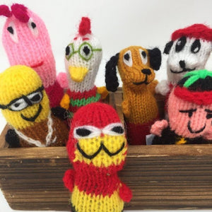 Close up picture of a collection of colorful hand-knitted catnip toys