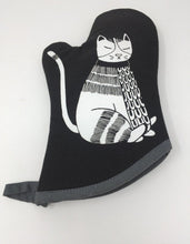 Picture of a black oven mitt with a white cat on it