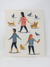 White sponge cloth dish rack towel with people and cats on it.