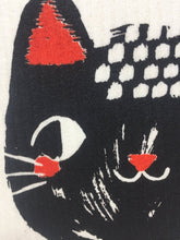 Load image into Gallery viewer, Close up picture of a black cat's face on a white sponge dish rack towel