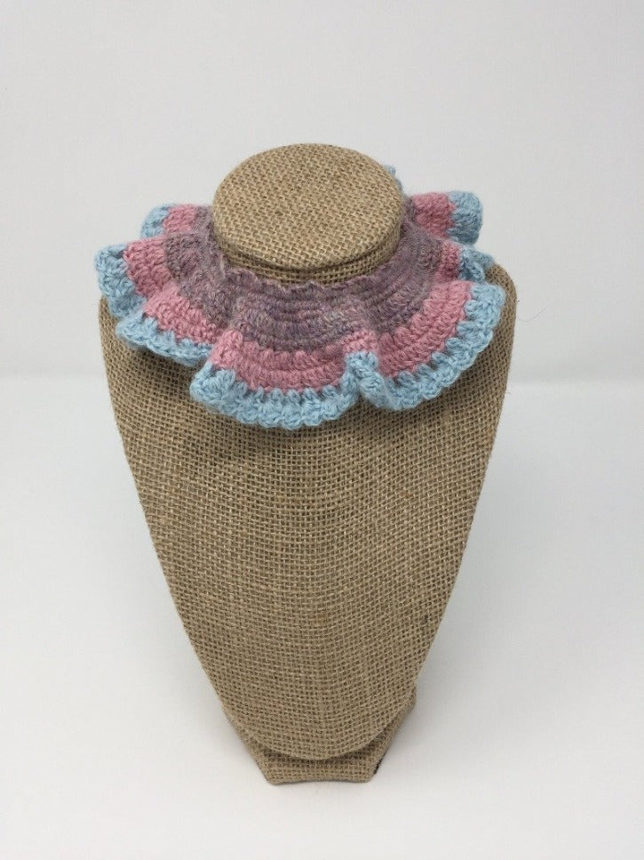 Picture of a pink, blue, and purple Hand Crochet Alpaca Wool Pet Collar around a tan brown bust
