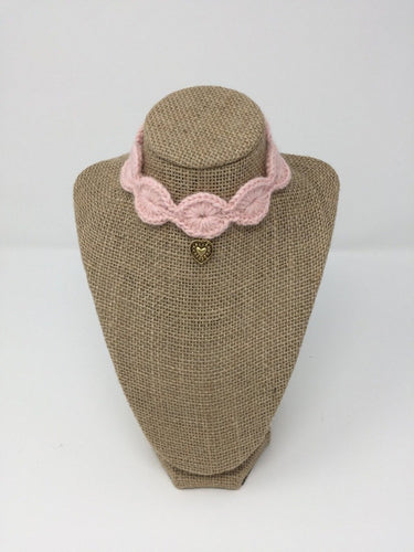 Pink Hand Crochet Alpaca Wool Pet Collars with gold colored pendant around a tan brown bust