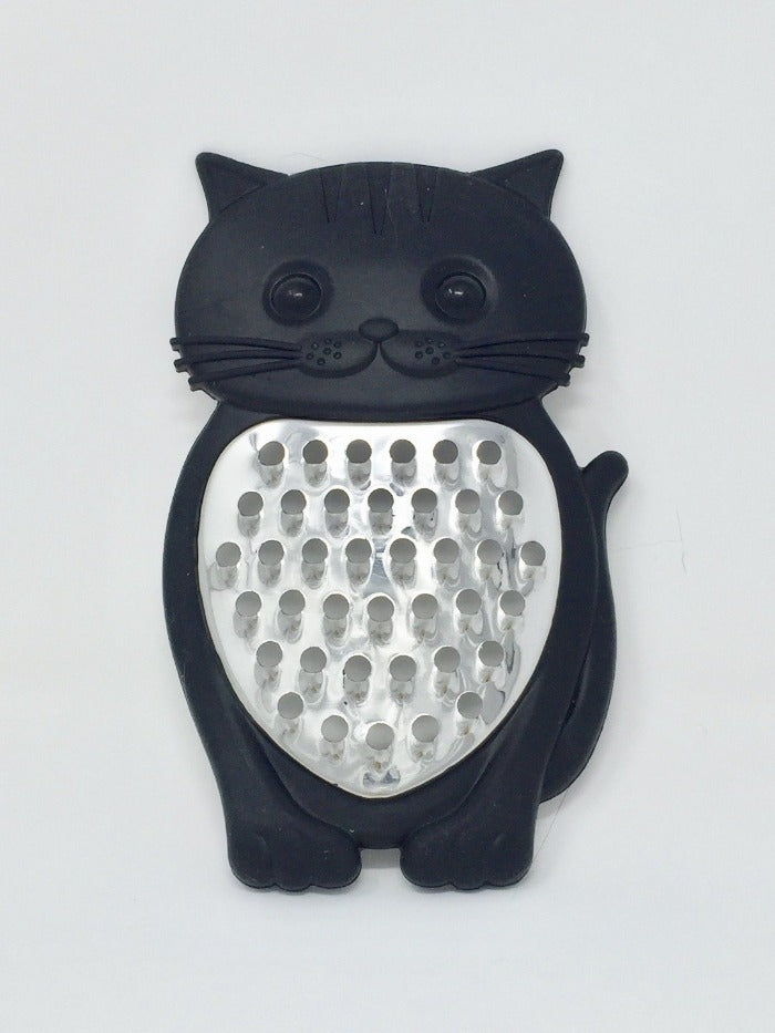 Picture of a black cat-themed grater with stainless steel front laying on a white surface
