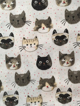 Load image into Gallery viewer, Close up picture of a white cat-themed kitchen towel featuring numerous cats on it