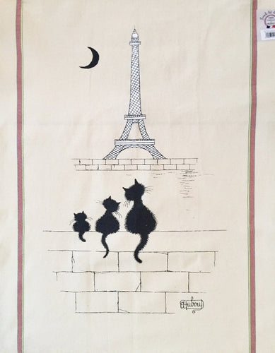 Off-white kitchen towel with three black cats watching the Eiffel Tower