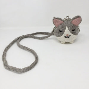 Picture of grey and white mini cat purse on white background