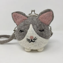 Close up picture of a grey and white mini cat purse on a white background