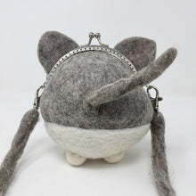 back view of a grey and white mini cat purse on a white background