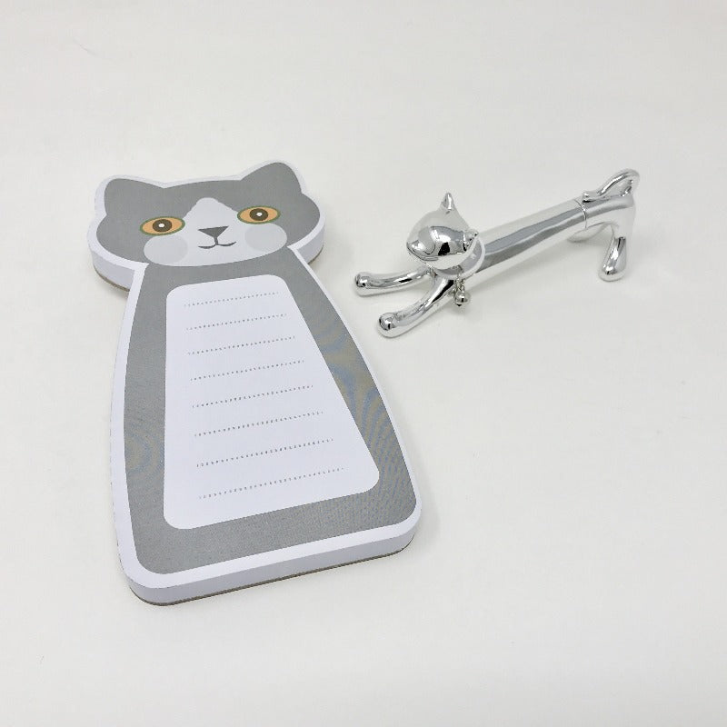Picture of grey and white cat-themed notepad with metallic silver cat pen