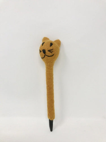 Picture of a brown colored felt cat pen laying on a white surface