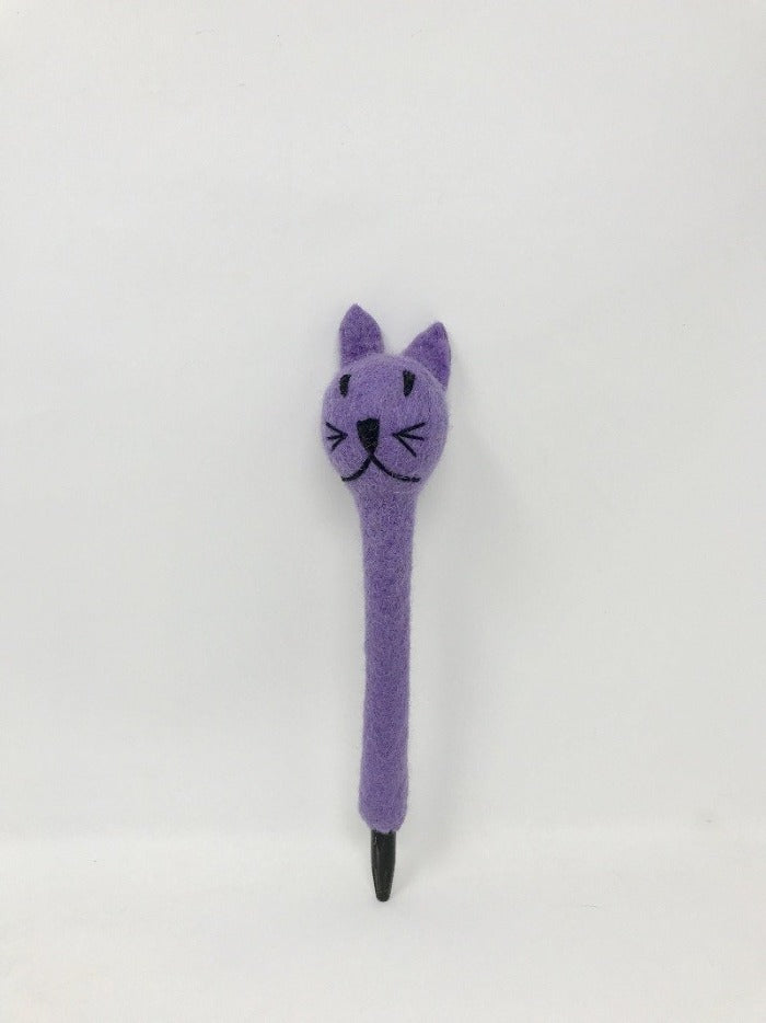 Picture of a lavender colored felt cat pen laying on an all white surface