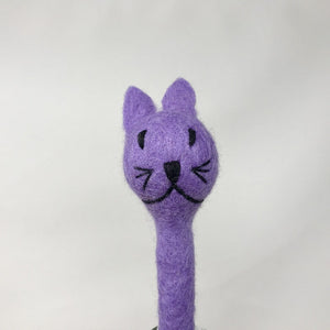 Close up picture of a lavender colored felt cat pen laying on an all white surface