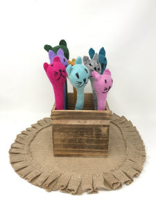 Picture of a collection of different colored felt cat pens inside of a wooden box