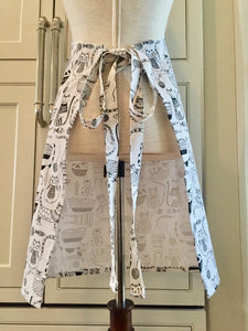 Back view of a black and white kitchen apron