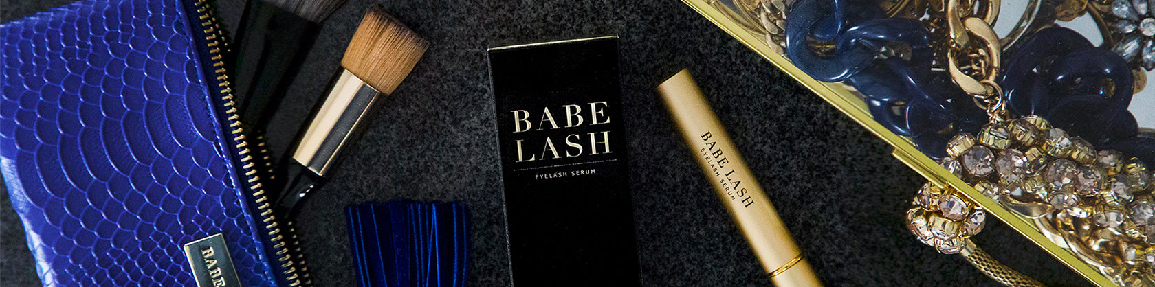 babe lash box and unboxed product on a table of makeup and jewelry
