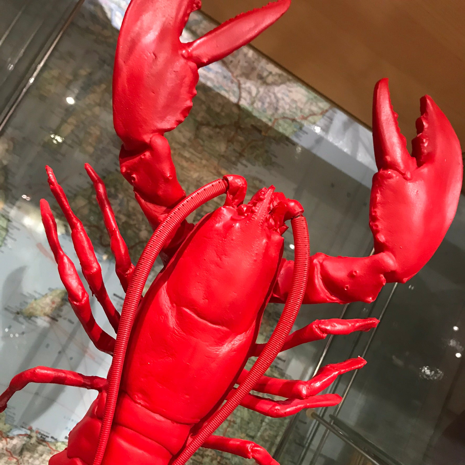Red faux lobster on stand