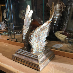 A Gold Pair of Angel Wings on Stand