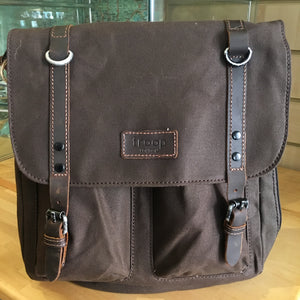 Dark brown messenger bag with leather straps and two front pockets