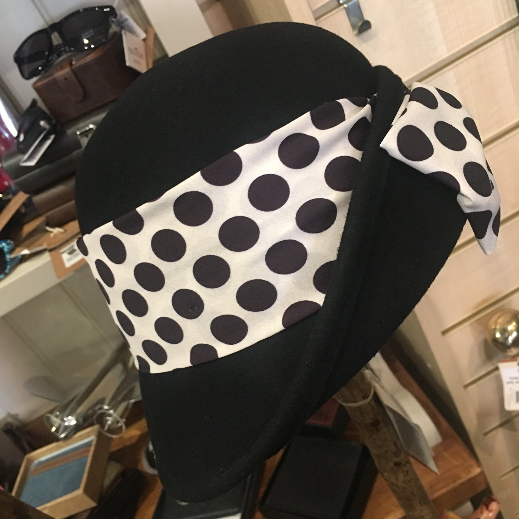 Cloche hat with decorative wide spotty ribbon