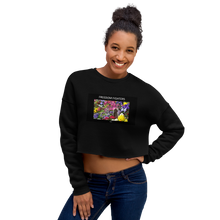 "This crop sweatshirt pays tribute to Harriet Tubman and Viola Desmond, women of African descent who fought for freedom in North America. Tubman freed hundreds of American slaves via the underground railroad. Viola Desmond refused to sit on the theater ""balcony for blacks"" in Canada. Her defiance eventually changed the law."