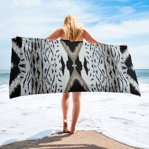 The Zebra patterned beach towel is striking to say the least. Pair it with any sexy black or white et al... bathing suit.