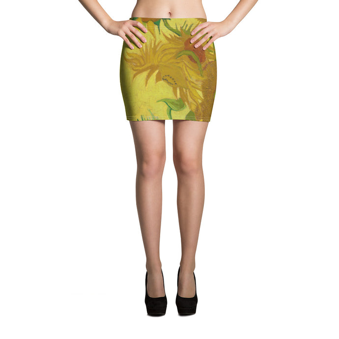 This yellow, green with touches of red mini skirt of gorgeous Van Gogh sun flowers is downright sexy!