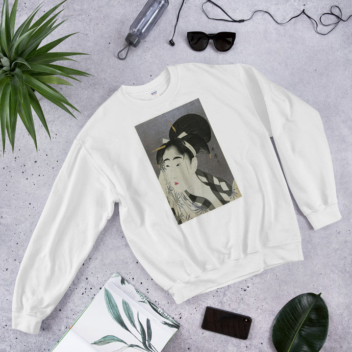 The image on this sweatshirt is of a woman wiping her face, probably after a performance. It is by Japanese 18th century artist Kitagawa Utamaro and represents an artistic technique called Ukiyo-e.  Using this technique artists during the 17th through 19th centuries produced woodblock prints and paintings of a variety of subjects including beautiful women; kabuki actors and sumo wrestlers. Principal colors are black and white.