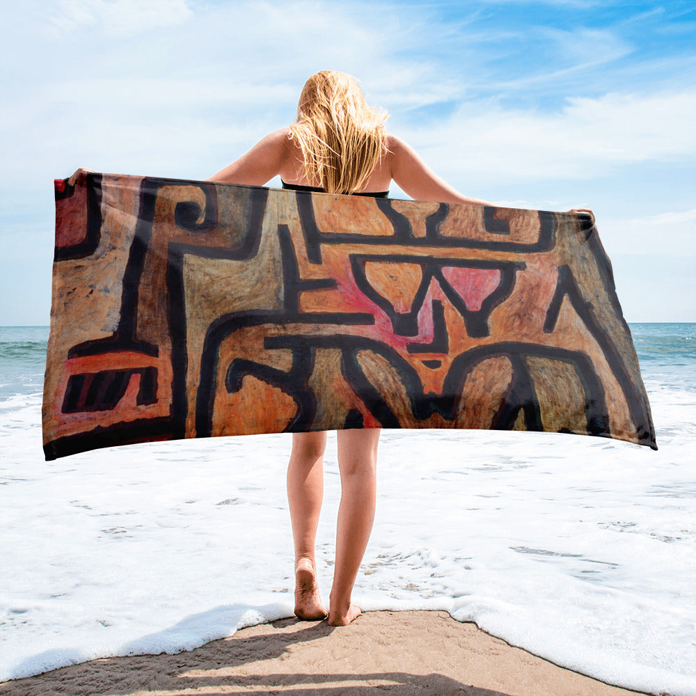 This beach towel's black, tan, pink and orange vibrant design is by Swiss born artist Paul Klee 18 December 1879 – 29 June 1940. Klee was influenced by various art movements including Expressionism, Cubism, and Surrealism.