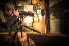 Photographer JB Manning shooting images from a blind in South Africa