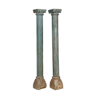 Antique Indian carved and painted teak columns with stone bases, from a Rajasthani haveli, sold as a pair
