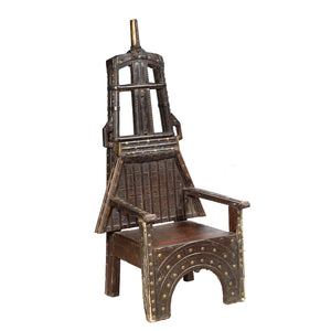 "Teak wood and brass ""throne"" chair made from components of an antique camel cart, India"