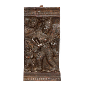 Antique Indian teak architectural panel of a musician