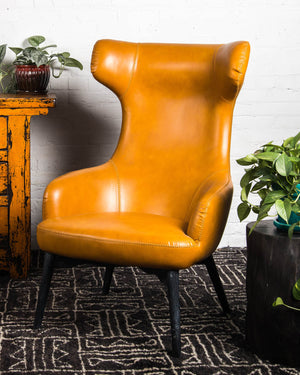 Mid-century style wing chair covered in vegan leather