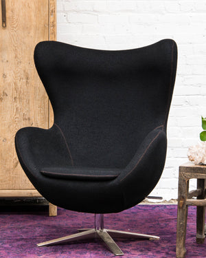 Mid-century style egg chair, covered in black wool