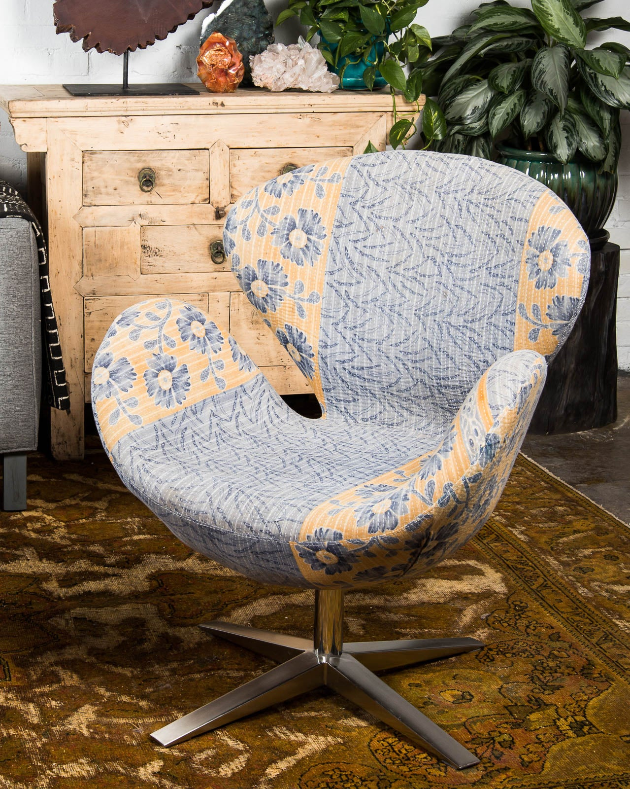 mid century style swan chair covered in vintage kantha textiles